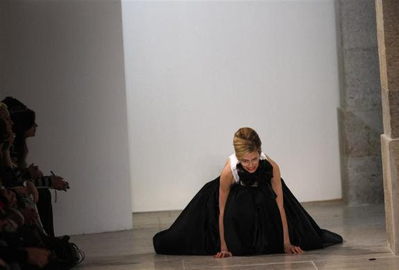 A model falls while presenting a creation by fashion designer Miguel Vieira as part of his Autumn-winter 2012 fashion collection during Lisbon Fashion Week, March 13, 2011. REUTERS-Rafael Marchante