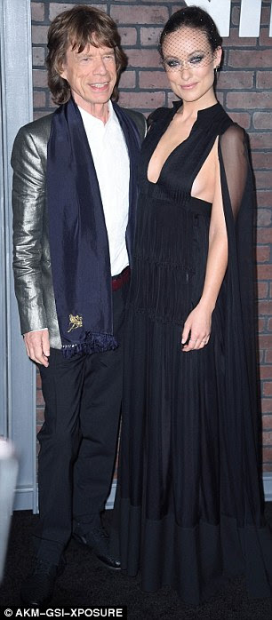 Living legend: Olivia happily posed up with Rolling Stones star Mick Jagger on the red carpet