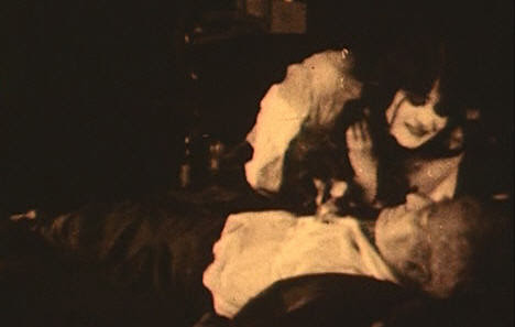 The Vampire grinning over her dead lover.