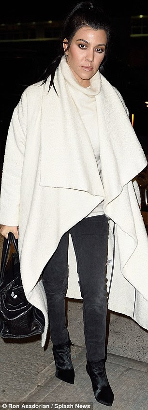 Kourtney wore a light grey sweater with long button-less coat that made her look ready for a winter wonderland.
