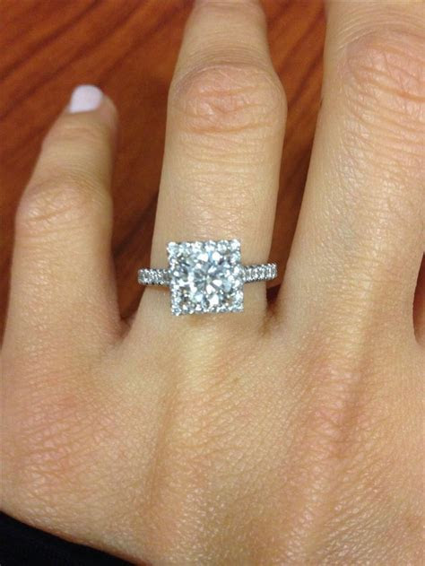 I LOVE my ring. Round cut center diamond, square halo