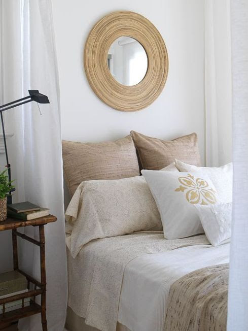 bedrooms - mushroom linen pillows bedding bullnose convex mirror faux bamboo nightstand table white drapes  Margot Austin  cottage bedroom design