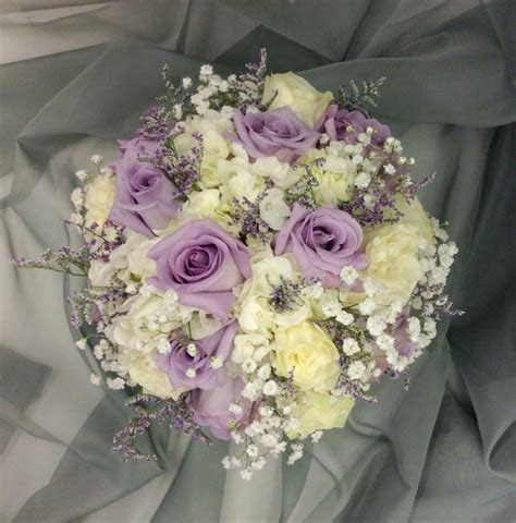 Lavender and white bridal bouquet with hydrangeas, roses