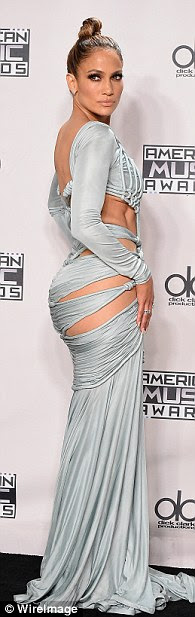 Booty: The host ended the evening on a light blue gown that hugged her famous curves