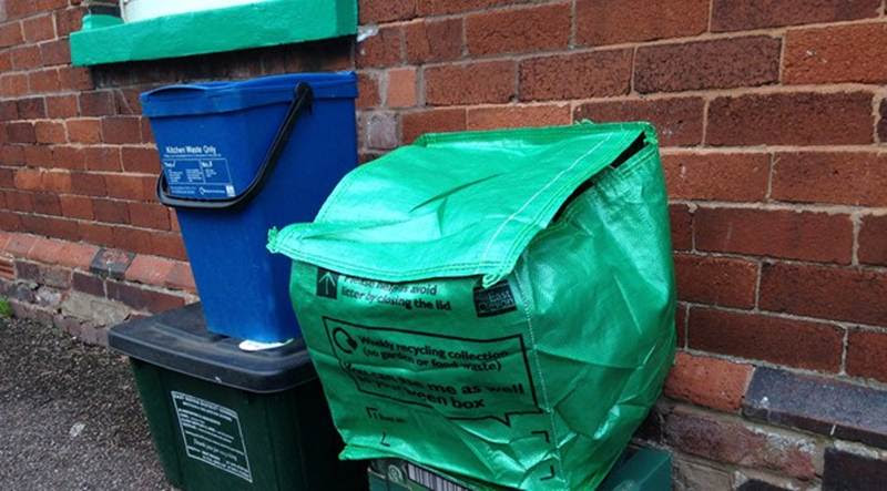 Residents involved in the trial in Exmouth and Feniton have recyclables collected via a green box and bag system, as well as weekly food waste collections.