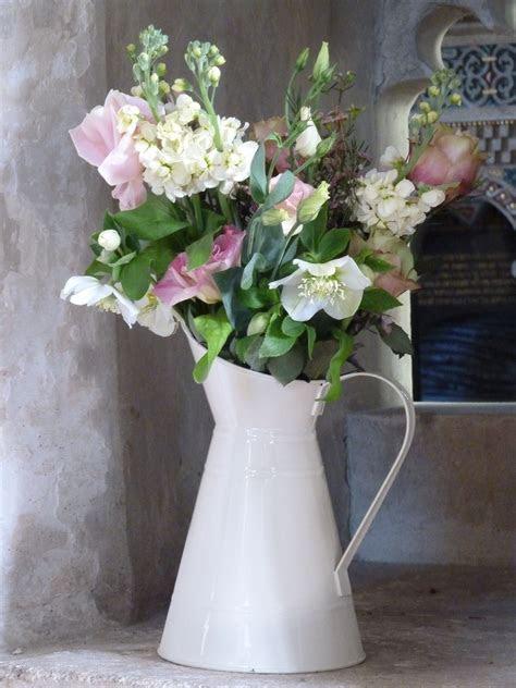 Vintage jugs of flowers including stocks, lisianthus