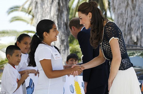 Royal snail  Kate races ahead with her painting at Inner-City Arts  campus whilst William is slow off the mark  4