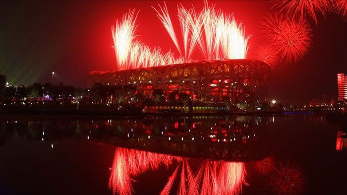 Fireworks erupt above Bird Nest Stadium in Beijing, China, during the Olympic opening ceremony on August 8, 2008.