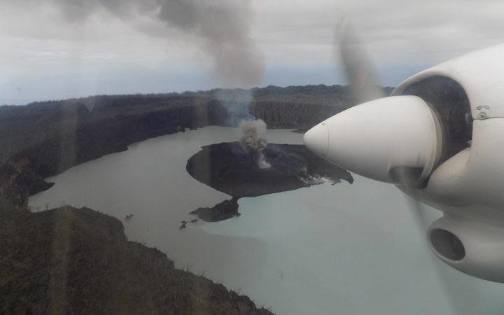 An aerial image of the smoking volcano in the centre of Ambae, Vanuatu, that's forced the evacuation of some 5,000 people.