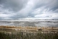 The weather begins to turn and beach fences are put in place in Grand Isle on October 4, 2013 in a mandatory evacuation ahead of Tropical Storm Karen