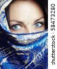 Close-up portrait of the female face in blue sari. Vertical photo - stock photo