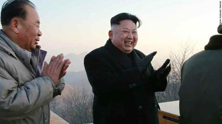 North Korean leader Kim Jong Un applauds Monday's ballistic missile launch.