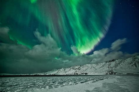 aurora borealis northern lights sky star mountain winter
