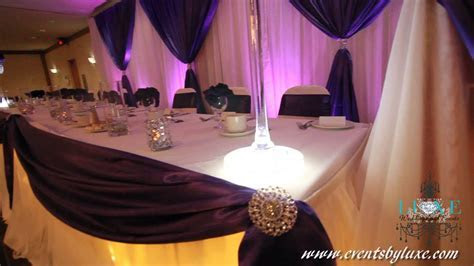 White and purple Wedding Decor by LUXE Weddings and Events