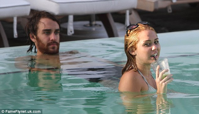 Newly engaged: The pool session comes after Miley has been basking in engagement bliss for the last two weeks after boyfriend Liam Hemsworth proposed to her on May 31