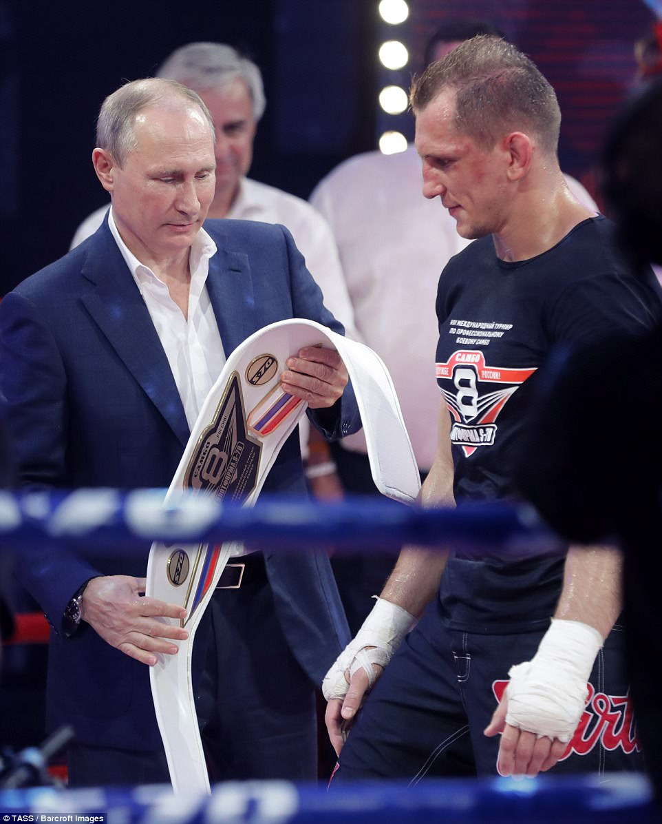 Kim, who boasts that his intercontinental rockets can reach the west coast of America, has warned the US that it would 'pay dearly' for UN sanctions it successfully imposed over the weekend, which were backed by China and Russia. The Russian President Vladimir Putin is pictured with fighter Vyacheslav Vasilevsky at the International Sambo Tournament In Sochi today