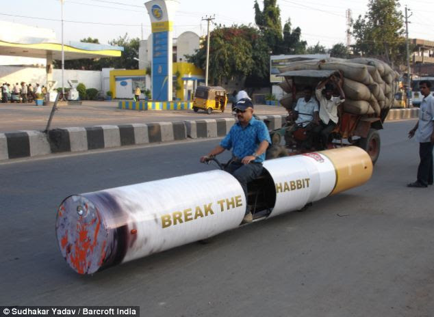 Health warning: One of Mr Yadav's cars, in the shape of a cigarette, makes its way down a road along with the other traffic