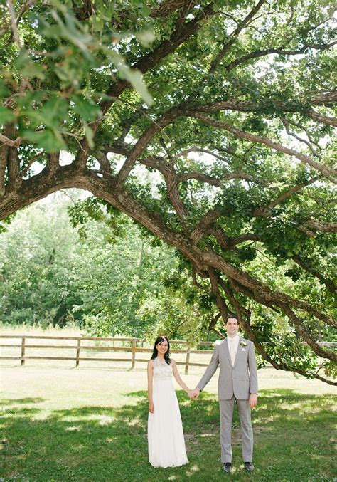 bride and groom under large old tree at Mayowood Stone