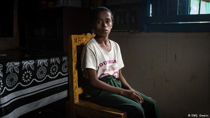 Rohingya boy sitting on a chair
