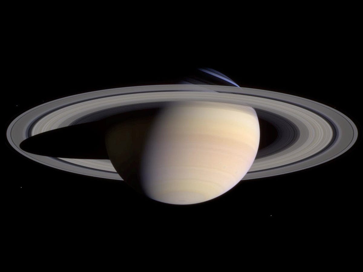Here Saturn appears to float. In fact, the planet is so gaseous it'd float on water (if there was an ocean big enough).