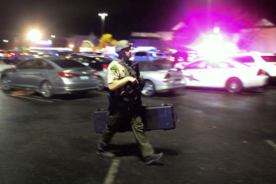 Authorities are pictured at the Cascade Mall following reports of an active shooter in Burlington, Washington