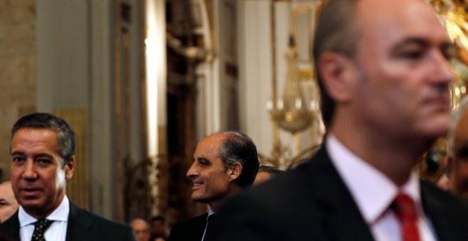 Los expresidents de la Generalitat valenciana Alberto Fabra (d), Eduardo Zaplana (i) y Francisco Camps (c), en la ceremonia de toma posesión como arzobispo de Valencia de Antonio Cañizares. EFE