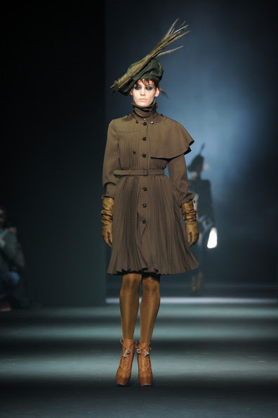 A model displays a creation by British designer Bill Gaytten for John Galliano Fall-Winter 2012-2013 Ready-To-Wear collection show during Paris Fashion Week.
