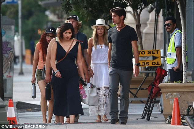 Summery:The actress rocked a wide-brim white hat and a summery strapless dress with lace hem