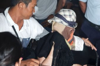 Schapelle Corby has her face concealed as she arrives at the Correctional Board of Denpasar on February 10, 2014