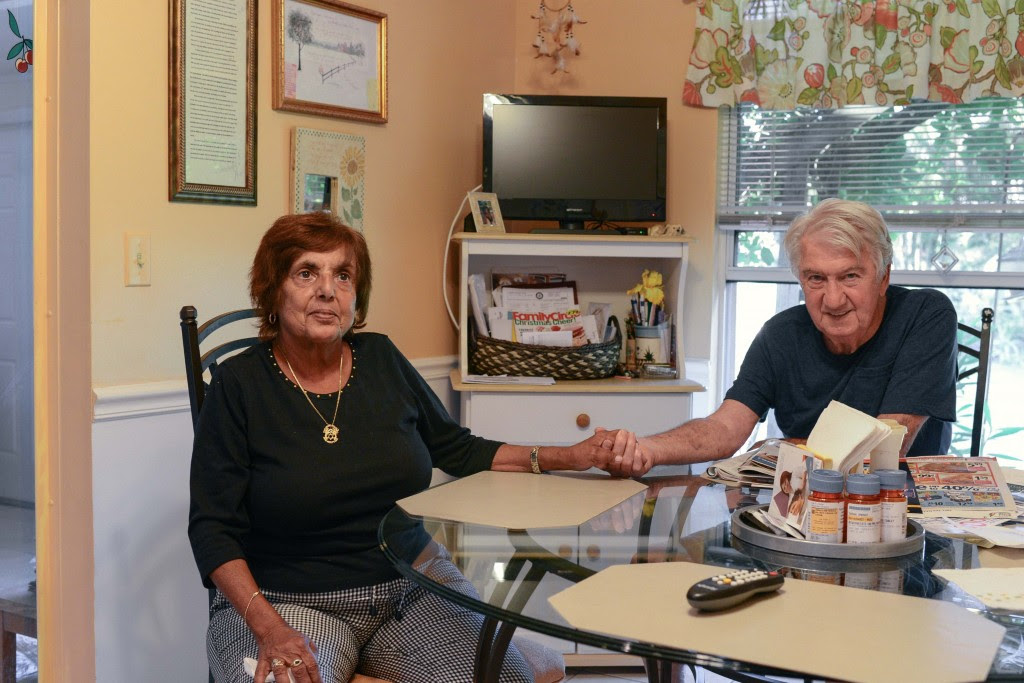 Harry Knight, right, used to be a jeweler and the main breadwinner of the family in New Jersey before he and Sarah Knight followed their daughter down to Naples. Photo by Ariel Min/PBS NewsHour