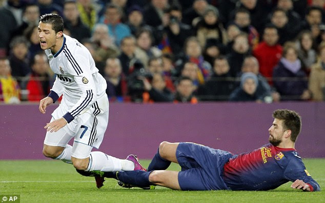 Cynical: Ronaldo was brought down by Gerard Pique in the penalty area in the 13th minute