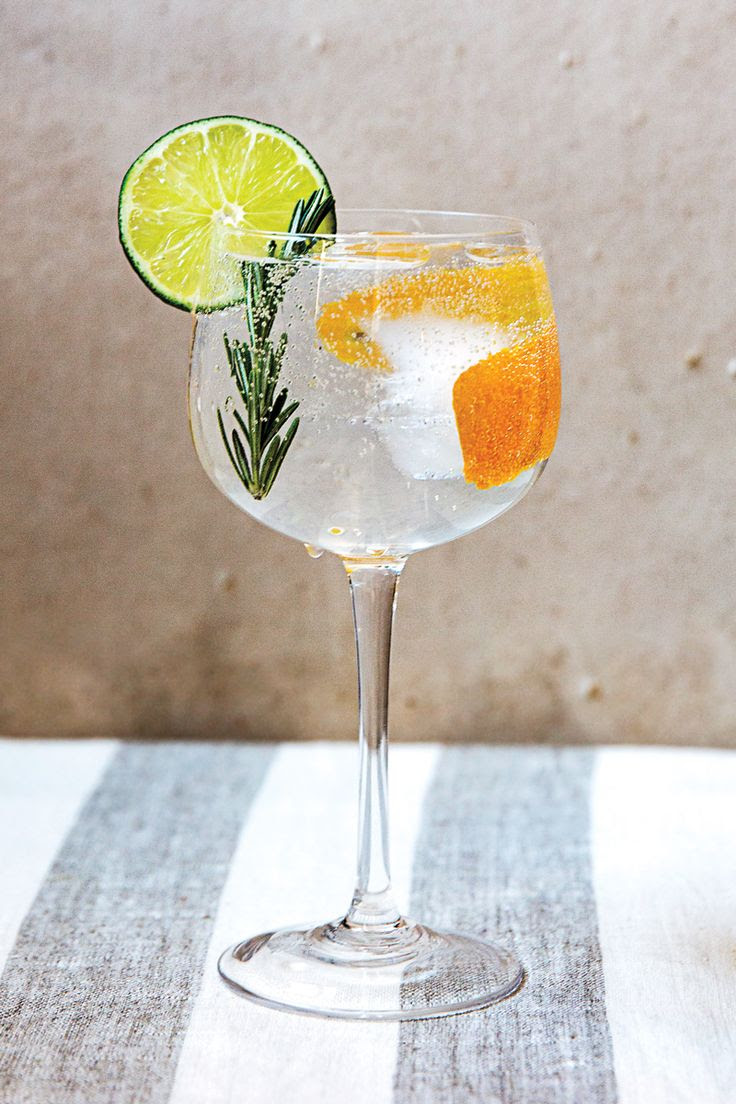 At Spanish-born chef José Andrés' U.S. restaurants, including the Washington, D.C.– and Las Vegas–based tapas bars called Jaleo, at least ten different variations on the gin and tonic are served. One of our favorites is this pretty version that's dressed with whole pink peppercorns, citrus, and rosemary. A dry gin lets the aromatic garnishes shine.