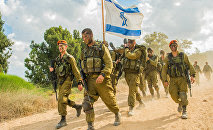 Soldiers from the IDF Home Front Command's Search and Rescue Brigade complete their beret march in southern Israel after finishing eight months of training