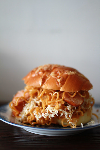 The Bin Tai II - Toasted Buns, Indomie, Sausages, Grated Cheese, Mayo