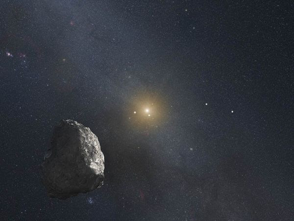 An artist's concept of a Kuiper Belt Object with the distant Sun and the outer planets in the background.