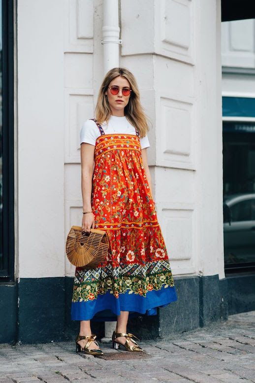 Le Fashion Blog Retro Sunglasses Patterned Midi Dress Layered T Shirt Tote Bag Metallic Heels Via Vogue Uk