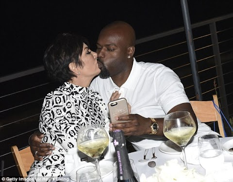 Momager Kris, 59, plants a huge kiss on toyboy Corey Gamble, 34, as she celebrates her new magazine cover with the Kardashian-Jenner gang