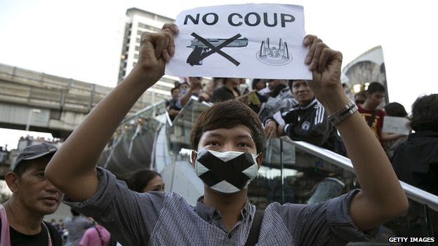 A Thai protester shows his disapproval with the military during an anti-coup protest in Bangkok - 23 May 2014