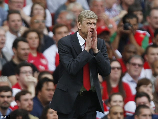 Hitting back: The club record signing sees Arsene Wenger defy his critics by spending big in the transfer market