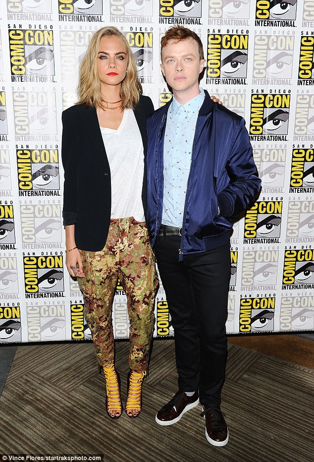 Stylish mix:For her panel discussing the new film with Dane Dehaan, the star donned a pair of tapered drop-crotch camouflage pants with a white V-neck T-shirt and a classic black jacket