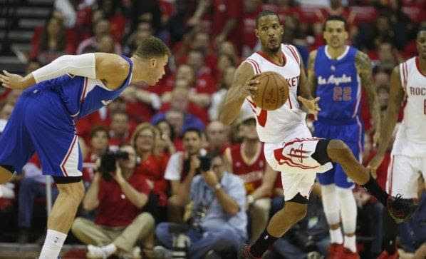 Houston Rockets forward Trevor Ariza (1) dribbles the ball past Los Angeles Clippers forward Blake Griffin (32) during the first quarter of Game 1 of the NBA Western Conference semifinals at Toyota Center Monday, May 4, 2015, in Houston. ( James Nielsen / Houston Chronicle )