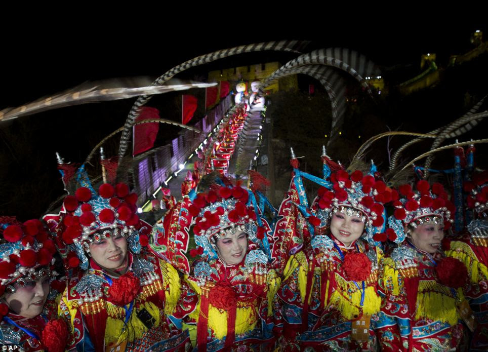 All together now, happy new year! Performers gather for a group photo after the end of a New Year's Eve count down to 2014 in Beijing, China
