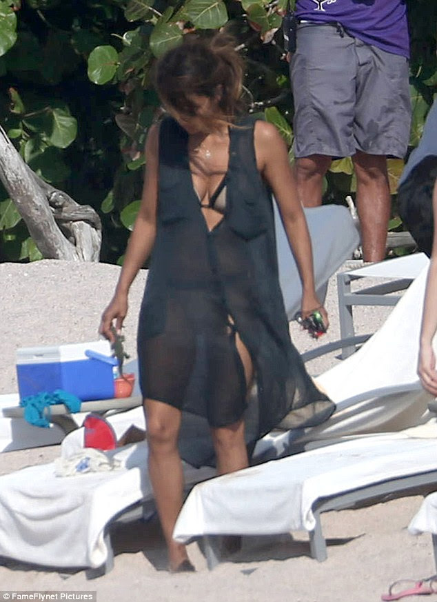 Always in style: Halle looked amazing as ever as she covered up her bikini with a sheer beach wrap