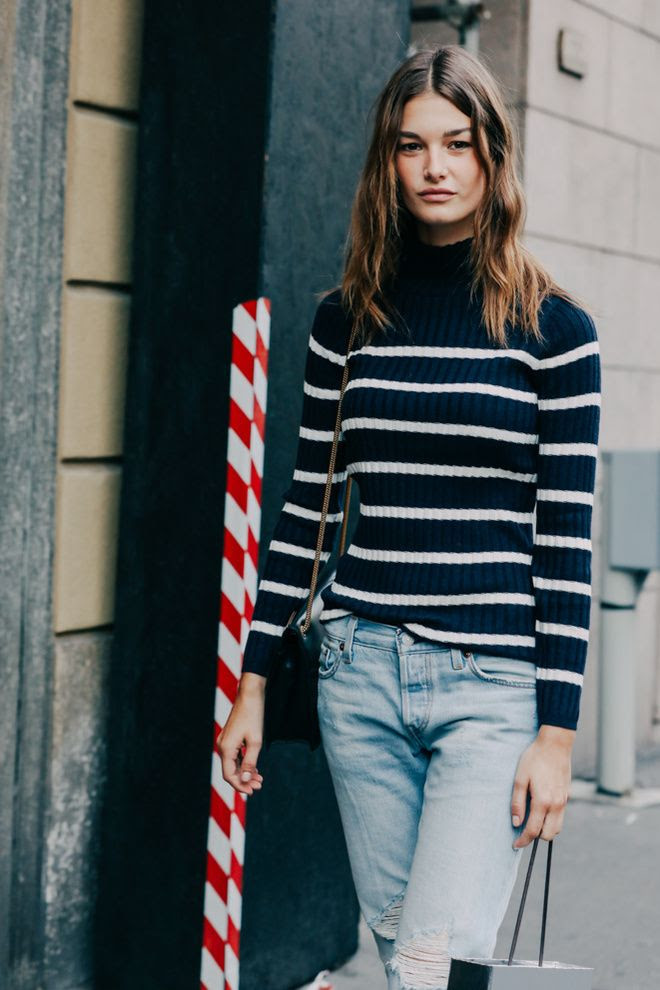 Le Fashion Blog Ophelie Guillermand Milan Fashion Week Model Off Duty Street Style Navy And Cream Striped Turtleneck Sweater Light Wash Distressed Boyfriend Jeans Via Vogue Paris