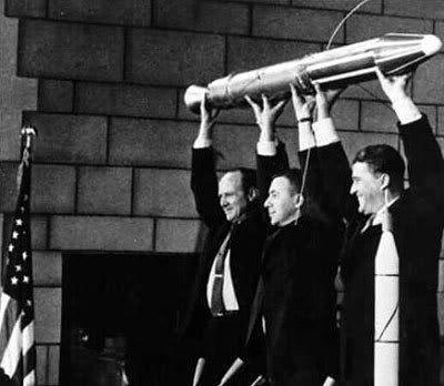 A model of Explorer 1, held by NASA Jet Propulsion Laboratory Director William Pickering, scientist James Van Allen and rocket pioneer Wernher von Braun in 1958.