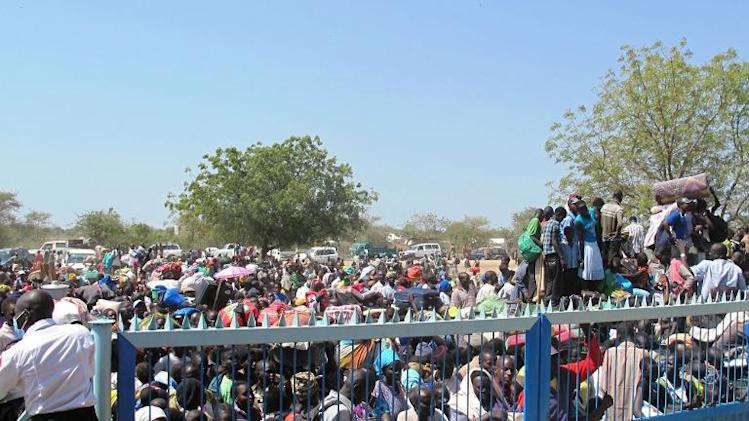 Civilians gather outside the UNMISS compound in Bor, South Sudan, on December 18, 2013 to seek refuge amid unrest