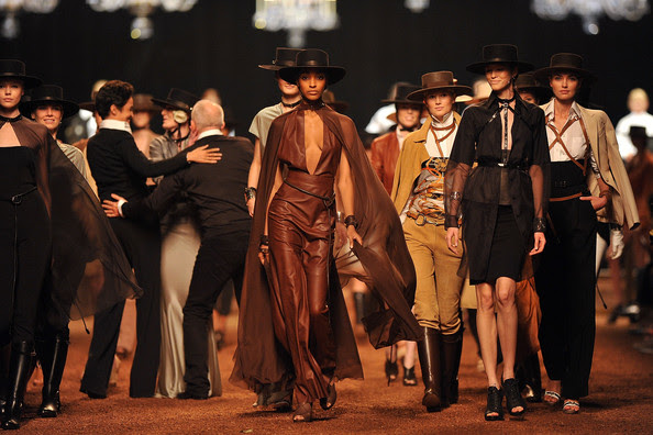 Designer Jean-Paul Gaultier, Farida Khelfa and models walk the runway during the Hermes Ready to Wear Spring/Summer 2011 show during Paris Fashion Week at Halle Freyssinet on October 6, 2010 in Paris, France.