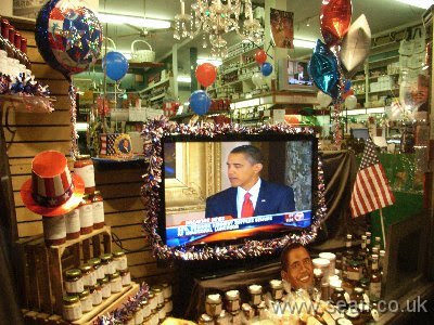 Grocery shop window decorated for Obama
