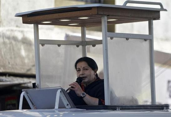 J. Jayalalithaa, chief minister of Tamil Nadu and chief of Anna Dravida Munetra Khazhgam (AIADMK), addresses her party supporters atop a vehicle during an election campaign rally in Chennai April 19, 2014. REUTERS-Babu-Files