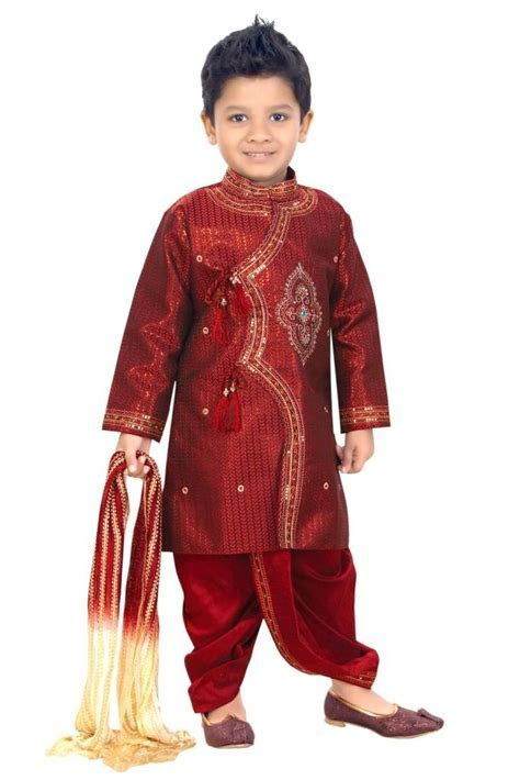 So cute, boy wearing red color Indian Jodhpuri. Typically